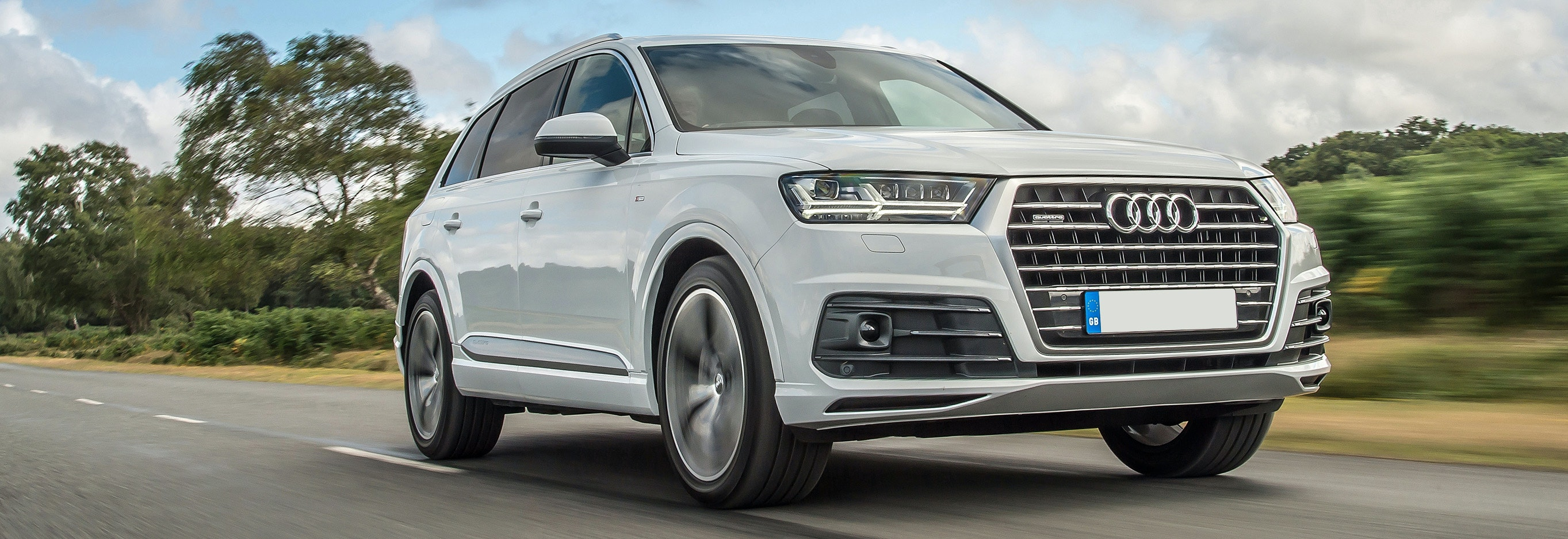 White Audi Q7 Driving, Viewed From The Front