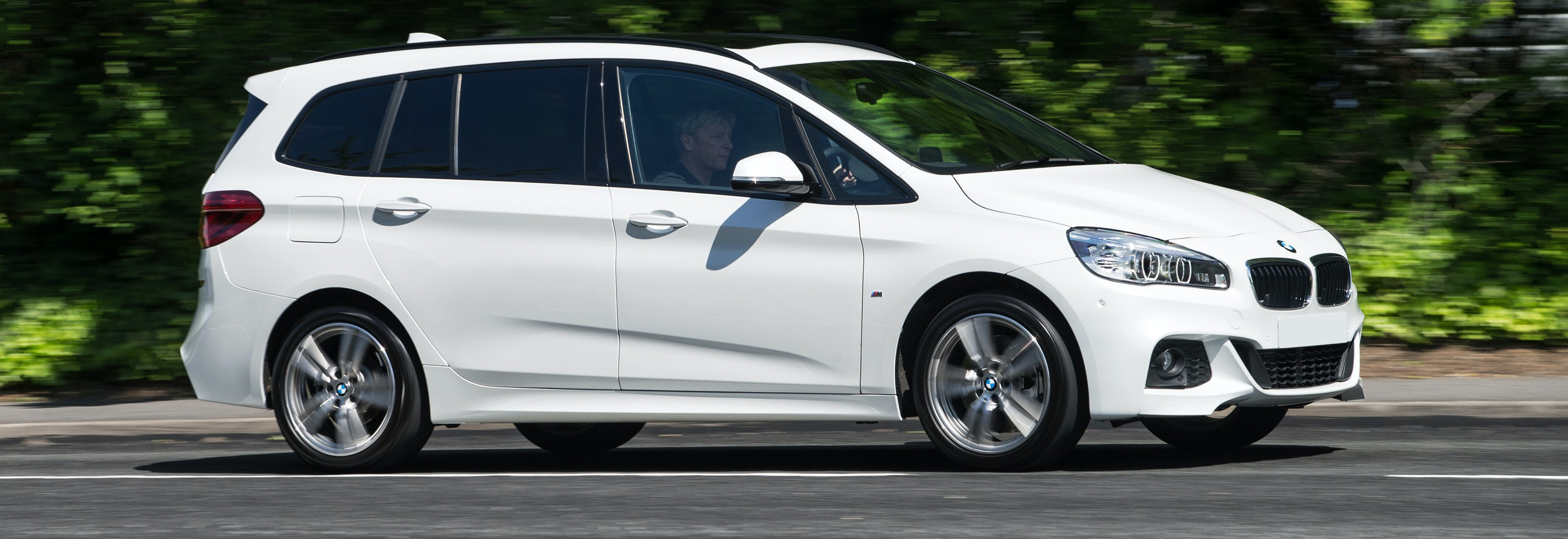 2018 bmw 2 series gran tourer white driving side profile