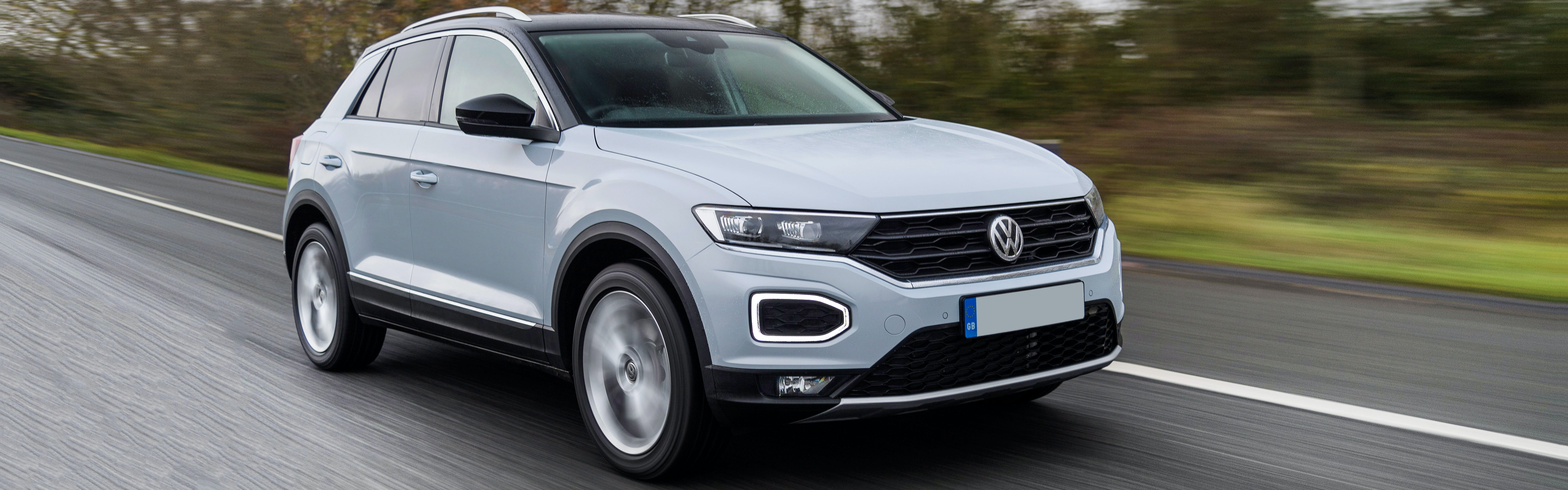 White Volkswagen T-Roc driving, viewed from the front