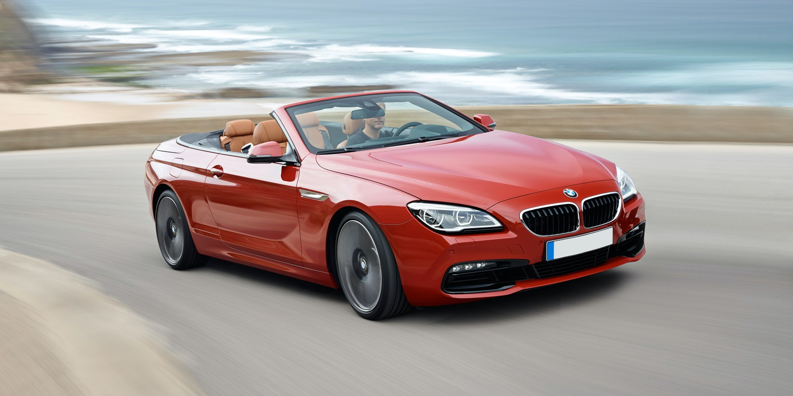 Bmw 6 series convertible red front driving.jpg?ixlib=rb 1.1