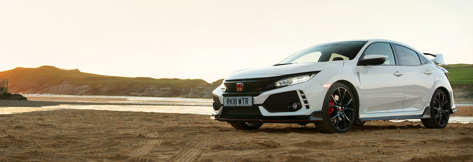 Championship White Honda Civic Type R parked, viewed from the front