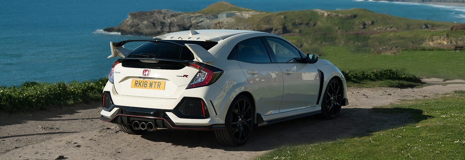 Championship White Honda Civic Type R parked, viewed from behind